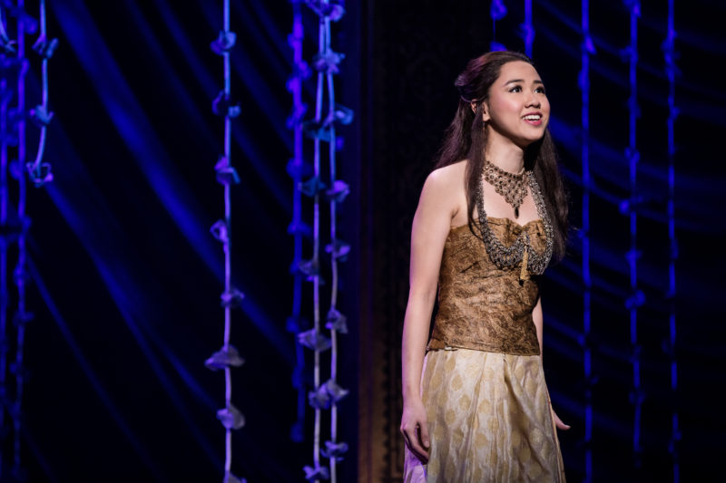 A Young Asian woman, named Tuptim, stands alone on stage.