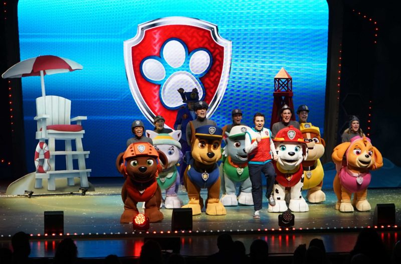 """The cast of PAW Patrol Live! """"Race to the Rescue"""" on stage during a performance."""