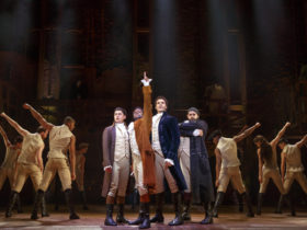 The cast of Hamilton on stage.